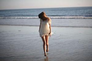 girl in white dress beach