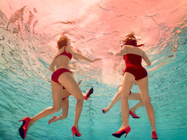 women in heels by the pool