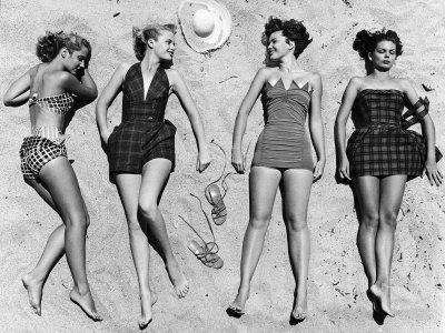 nina-leen-models-sunbathing-wearing-latest-beach-fashions
