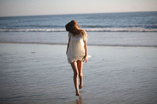 girl in white dress beach